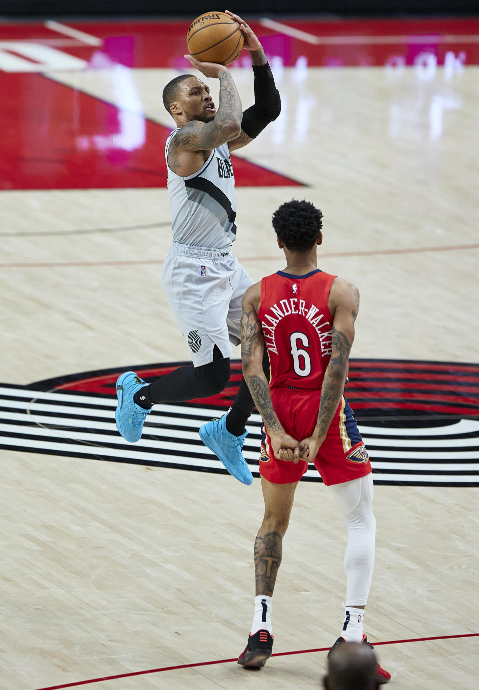 Portland Trail Blazers guard Damian Lillard shoots a 3-point basket over New Orleans Pelicans guard Nickeil Alexander-Walker during the second half of an NBA basketball game in Portland, Ore., Tuesday, March 16, 2021. (AP Photo/Craig Mitchelldyer)