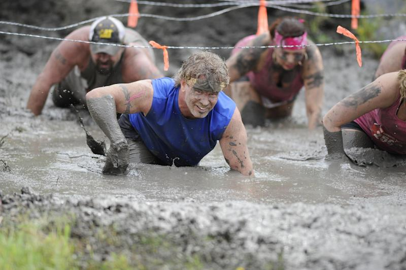 This Saturday, April 27, 2013 photo provided by Nuvision Action Image LLC shows a contestant in The Mud Monster competing during The Survival Race in Dallas. (AP Photo/Nuvision Action Image LLC, J. Dennis Thomas)