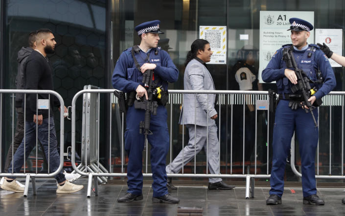 Police stand outside Christchurch High Court as family and survivors from the March 2019 Christchurch mosque shootings arrive for the sentencing of 29-year-old Australian Brenton Harrison Tarrant, in Christchurch, New Zealand, Monday, Aug. 24, 2020. Tarrant has pleaded guilty to 51 counts of murder, 40 counts of attempted murder and one count of terrorism in the worst atrocity in the nation's modern history. (AP Photo/Mark Baker)