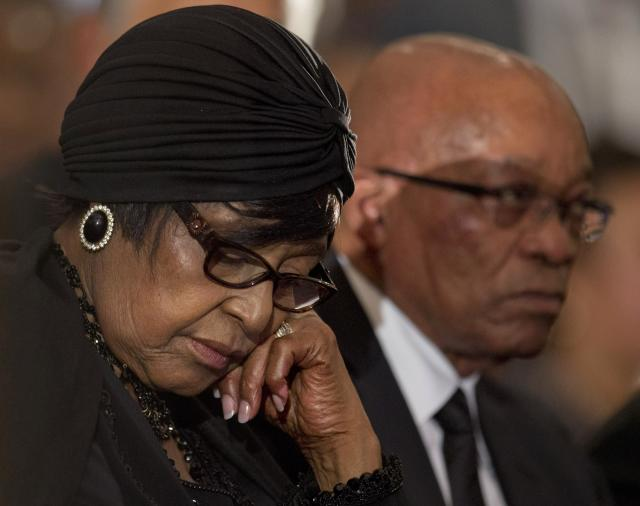 <p>Winnie Madikizela-Mandela, left, Nelson Mandela's former wife, and South African President Jacob Zuma attend a memorial service for Mandela at the Bryanston Methodist Church near Johannesburg, South Africa, on Dec. 8, 2013. (Photo: Peter Dejong/AP) </p>