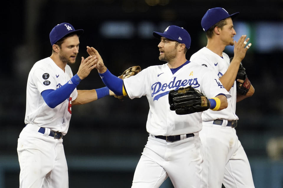 Los Angeles Dodgers' Trea Turner, AJ Pollock and Corey Seager, from left, celebrate the team's win over the Atlanta Braves in a baseball game Wednesday, Sept. 1, 2021, in Los Angeles. (AP Photo/Marcio Jose Sanchez)