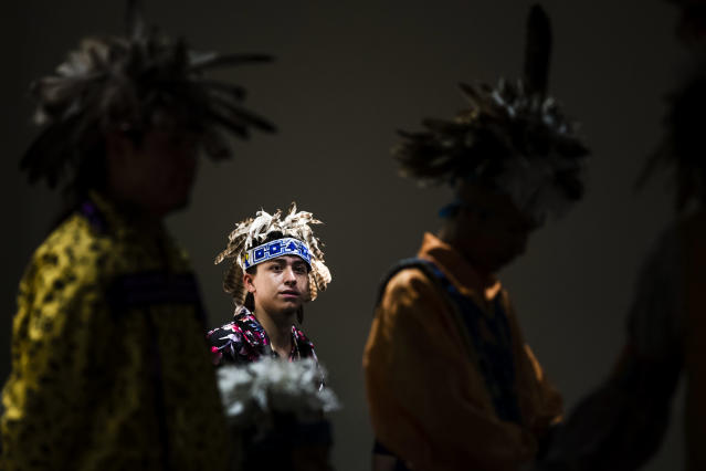 <p>Aaron Miller stands by to preform with the Longhouse Singers and Dancers representing the Oneida Nation at the Museum of the American Revolution in Philadelphia, Pa., Monday, Oct. 9, 2017. (Photo: Matt Rourke/AP) </p>