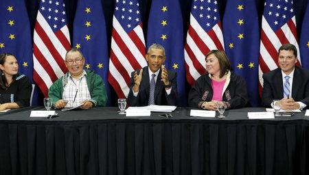 U.S. President Barack Obama (C) participates in a roundtable with Alaska natives before delivering remarks to the GLACIER Conference at the Dena'ina Civic and Convention Center in Anchorage, Alaska August 31, 2015. REUTERS/Jonathan Ernst