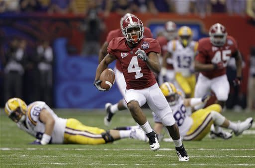 Alabama's Marquis Maze returns a punt 49 yards during the first half of the BCS National Championship college football game against LSU Monday, Jan. 9, 2012, in New Orleans. (AP Photo/David J. Phillip)