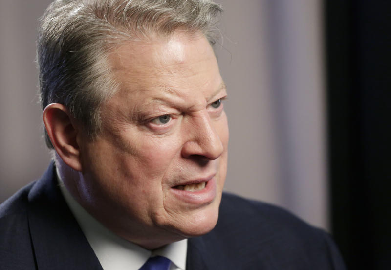 "Former U.S. Vice President Al Gore talks during an interview, Tuesday, Jan. 29, 2013 in New York. Gore, who takes aim in his new book at the corporate media for ""suffocating the free flow of ideas,"" on Tuesday defended the sale of his own television channel to Al-Jazeera. (AP Photo/Mark Lennihan)"