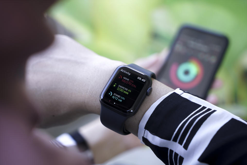 Bali Indonesia 2 April 2020 : Woman  using smart watch and smart phone, Apple watch