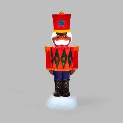 """<p><strong>Wondershop</strong></p><p>target.com</p><p><strong>$10.00</strong></p><p><a href=""""https://www.target.com/p/lit-blow-mold-nutcracker-decorative-figurine-red-wondershop-8482/-/A-79475946"""" rel=""""nofollow noopener"""" target=""""_blank"""" data-ylk=""""slk:Shop Now"""" class=""""link rapid-noclick-resp"""">Shop Now</a></p><p>Complete your Christmas display with this traditional, light-up nutcracker figurine, guaranteed to add extra cheer to any room.</p>"""