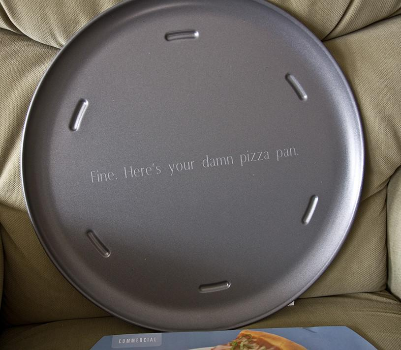"""<p>""""For years, my dad put a pizza pan on his Christmas list, and I refused to get it because it was too boring of a gift. This year, I finally broke down and got him one. And I got it engraved."""" [Photo: Reddit/starsspinningdizzy] </p>"""