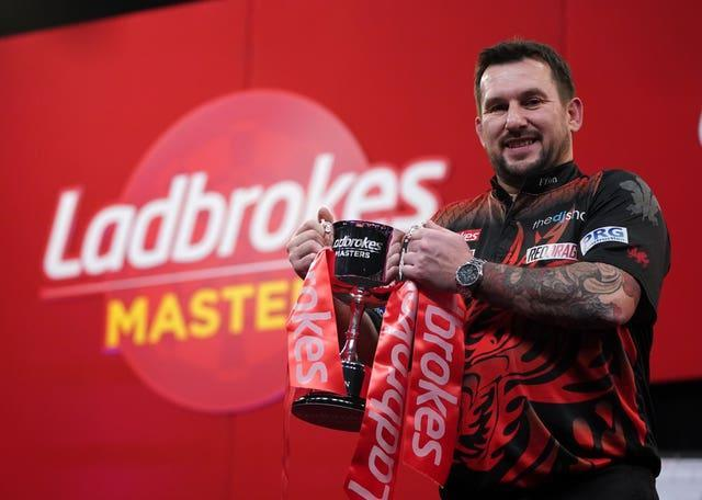 Jonny Clayton poses with the 2021 Ladbrokes Masters trophy