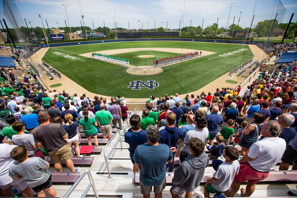 Fans and players stand up for the National Anthem before the Notre Dame vs. Central Michigan NCAA tournament baseball game Friday, June 4, 2021 at Frank Eck Stadium in South Bend.