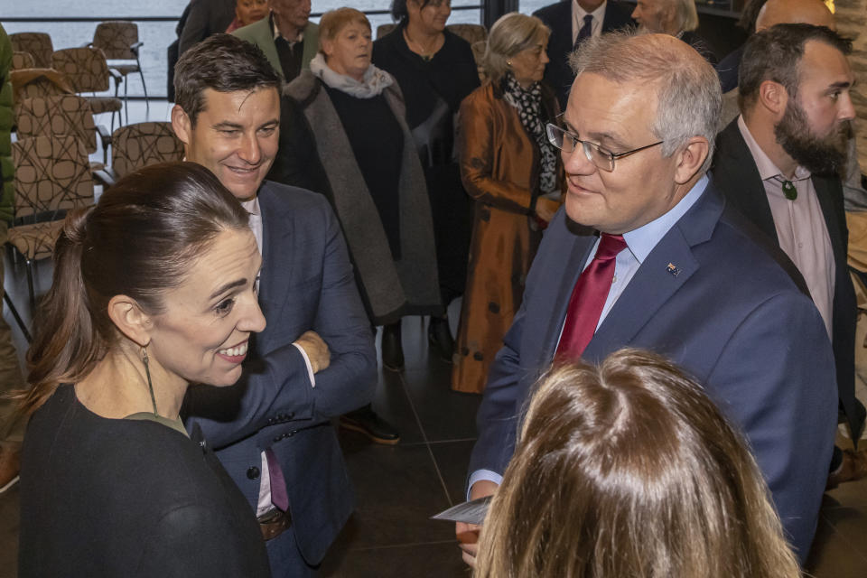 Australian Prime Minister Scott Morrison, right, chats with New Zealand Prime Minister Jacinda Ardern, left, and her partner Clarke Gayford, second from left, after powhiri (traditional Maori greeting) at the annual Australia-New Zealand Leaders' Meeting at the Rees Hotel in Queenstown, New Zealand, Sunday, May 30, 2021. Growing friction with China and how to reopen borders after the pandemic will likely be among the topics discussed by the leaders of Australia and New Zealand in their first face-to-face meeting since the coronavirus outbreak began. (Peter Meecham/AAP Image via AP)