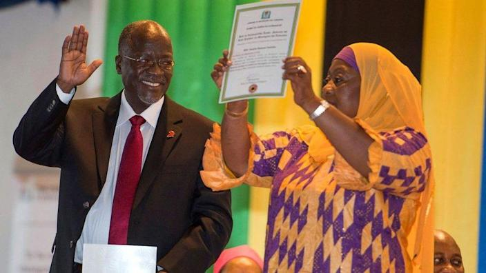 Tanzania's President-elect John Magufuli (L) gestures as Vice President-elect Samia Suluhu holds up a certificate during the official election announcement ceremony in Dar es Salaam October 30, 2015.