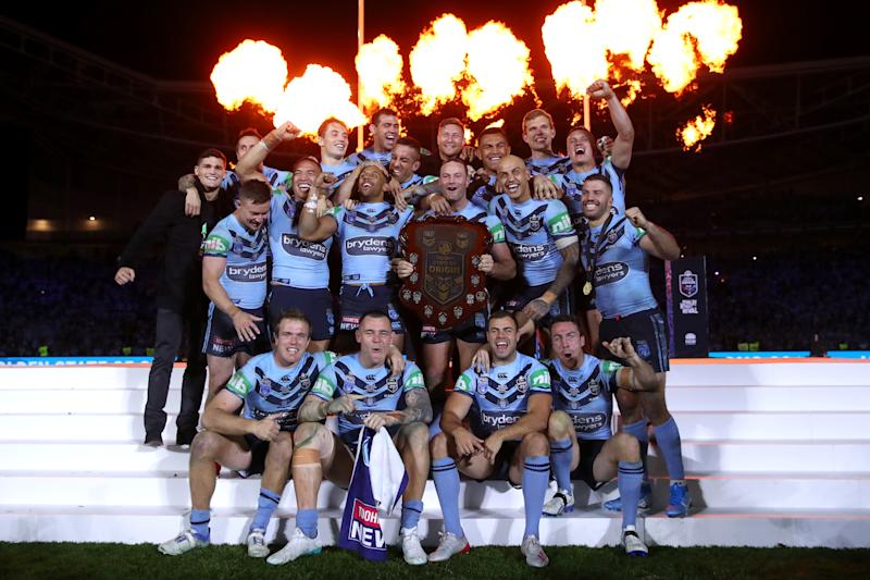 The NSW Blues celebrate retaining the State of Origin trophy.