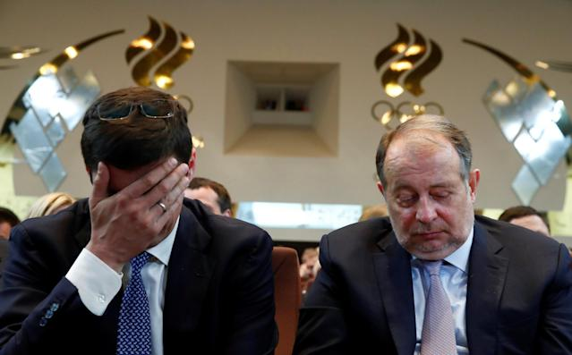 Former Russian Olympic swimming champion and candidate for the Russian Olympic Committee presidency, Alexander Popov and Vladimir Lisin, chairman of the board of directors of Russian steelmaker NLMK, attend a meeting to vote for a new head of the committee at its headquarters in Moscow, Russia May 29, 2018. REUTERS/Maxim Shemetov