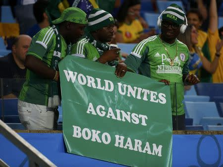 Nigerian fans hold a banner against Boko Haram during their 2014 World Cup Group F soccer match agaisnt Bosnia at the Pantanal arena in Cuiaba