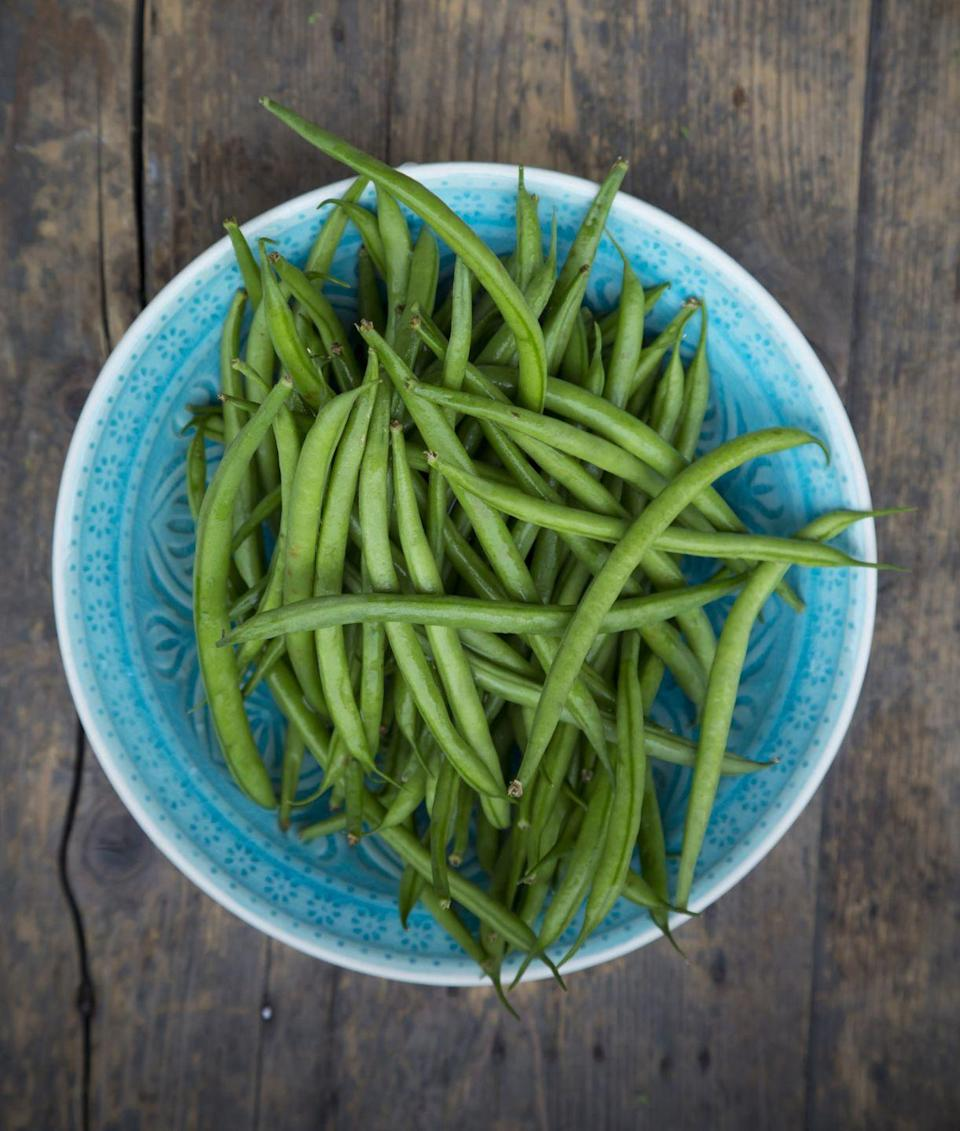 """<p>Like frozen varieties in the supermarket, the key to cooking tender string beans in the microwave is to steam them in a covered casserole container. You'll learn how to steam a pound of green beans in the microwave with handy Thanksgiving shortcut tips below.</p><p><em><a href=""""https://www.goodhousekeeping.com/holidays/thanksgiving-ideas/g2929/microwave-cooking-thanksgiving-shortcuts/"""" rel=""""nofollow noopener"""" target=""""_blank"""" data-ylk=""""slk:Learn how to steam string beans in the microwave »"""" class=""""link rapid-noclick-resp"""">Learn how to steam string beans in the microwave »</a></em></p>"""