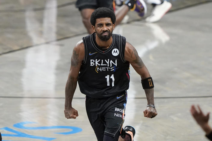 Brooklyn Nets' Kyrie Irving (11) celebrates after making a 3-point basket during the second half of an NBA basketball game against the New York Knicks Monday, April 5, 2021, in New York. (AP Photo/Frank Franklin II)