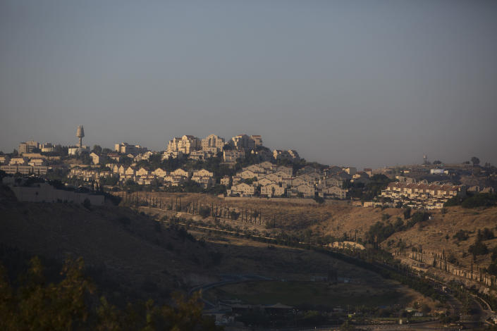 """This Monday, June 29, 2020 photo shows an area near Israeli settlement of Maale Adumim, in the West Bank. The U.N.'s human rights chief Michelle Bachelet said that Israel's plan to begin annexing parts of the occupied West Bank would have """"disastrous"""" consequences for the region, issuing her dire warning as senior U.S. and Israeli officials were meeting in Jerusalem trying to finalize the move. (AP Photo/Sebastian Scheiner)"""