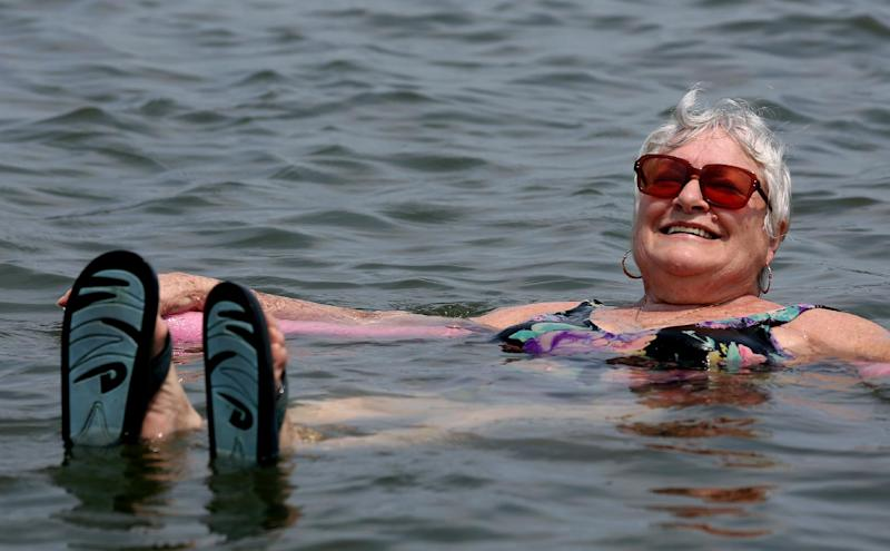 Lillian Mariscalo of Oyster Bay, N.Y. cools off in the waters of an Oyster Bay beach on Long Island's North shore Saturday, July 7, 2012. The heat gripping much of the country was set to peak Saturday in several places, with temperatures of more than 100 degrees expected in Philadelphia, excessive heat warnings in the Midwest and ongoing power outages of more than a week in the mid-Atlantic. (AP Photo/Craig Ruttle)