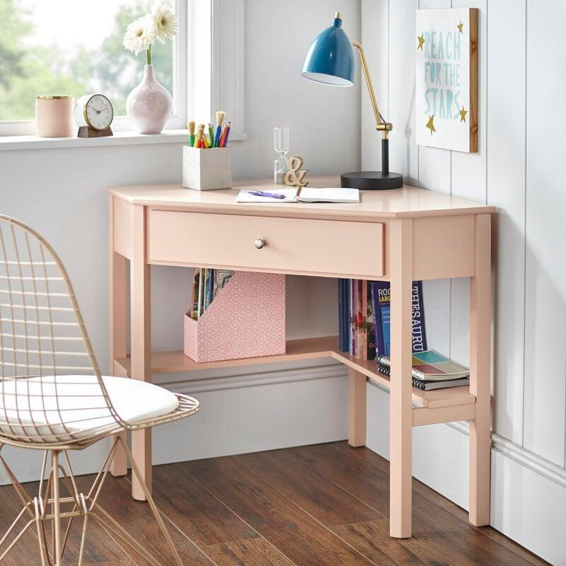 """<h2>Andover Mills Suri Corner Desk</h2><br><strong>Deal: 10% Off</strong><br>Corner desks are the unsung heroes of work from home set-ups — they disguise themselves as casual living room accents but double as full-blown workspaces when you need them. This desk was a total hit in 2020 and is still a certified score this year. <br><br><em>Shop</em> <strong><em><a href=""""https://www.wayfair.com/furniture/pdp/andover-mills-suri-corner-desk-w000796135.html"""" rel=""""nofollow noopener"""" target=""""_blank"""" data-ylk=""""slk:Andover Mills"""" class=""""link rapid-noclick-resp"""">Andover Mills</a></em></strong><br><br><strong>Andover Mills</strong> Suri Corner Desk, $, available at <a href=""""https://go.skimresources.com/?id=30283X879131&url=https%3A%2F%2Fwww.wayfair.com%2Ffurniture%2Fpdp%2Fandover-mills-suri-corner-desk-w000796135.html"""" rel=""""nofollow noopener"""" target=""""_blank"""" data-ylk=""""slk:Wayfair"""" class=""""link rapid-noclick-resp"""">Wayfair</a>"""
