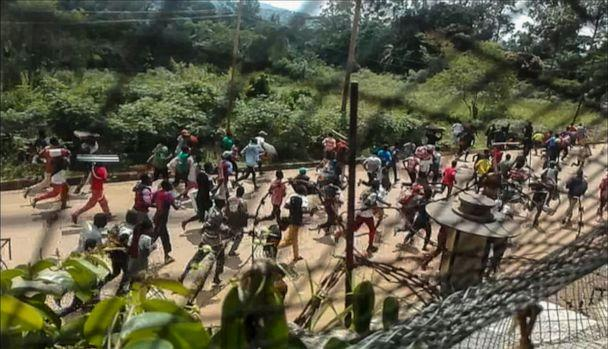 PHOTO: This frame grab taken from video footage shows crowds fleeing with items after they stormed a United Nations compound on the outskirts of the eastern town of Beni, Democratic Republic of Congo, Nov. 25, 2019. (Ushindi Mwendapeke Eliezaire/AFP via Getty Images)