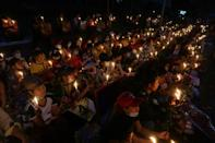 Protesters hold a candlelight vigil outside the US embassy in Myanmar's commercial capital Yangon during a demonstration against the coup