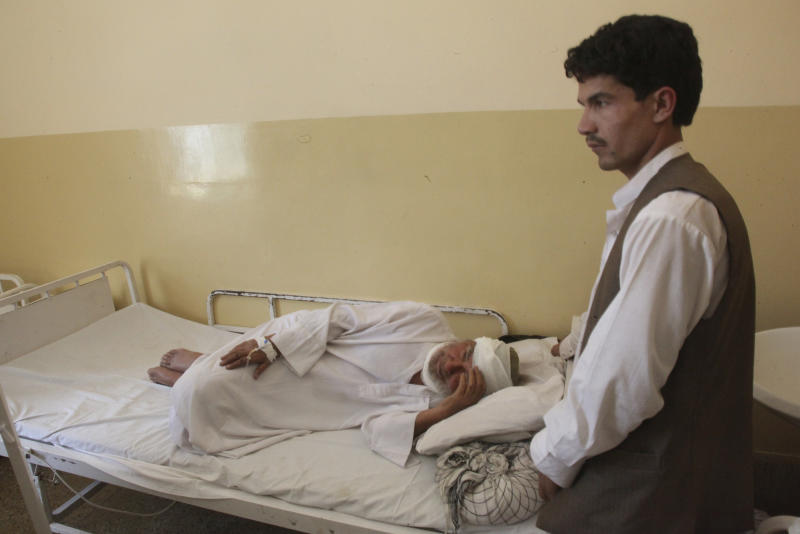 An Afghan man who was wounded in a suicide attack lies in a hospital in Samangan province north of Kabul Afghanistan, Saturday, July, 14, 2012. A suicide bomber blew himself up Saturday in a wedding hall in northern Afghanistan, killing at least 23 people including a prominent warlord-turned-politician and three Afghan security force officials, in an attack that deals a setback to efforts to unify the nation's ethnic factions, Afghan officials said. (AP Photo/Jawed Dehsabzi)