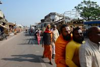 Hindu men make their way along a road in Ayodhya on November 9, 2019, ahead of a Supreme Court verdict on the disputed religious site. - India braced on November 9 for a Supreme Court ruling over a holy site contested for centuries by Hindus and Muslims, which in 1992 sparked some of the deadliest sectarian violence since independence. (Photo by SANJAY KANOJIA / AFP) (Photo by SANJAY KANOJIA/AFP via Getty Images)