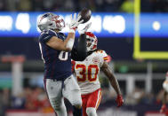 New England Patriots tight end Rob Gronkowski, left, catches a pass in front of Kansas City Chiefs safety Josh Shaw (30) during the second half of an NFL football game, Sunday, Oct. 14, 2018, in Foxborough, Mass. (AP Photo/Michael Dwyer)