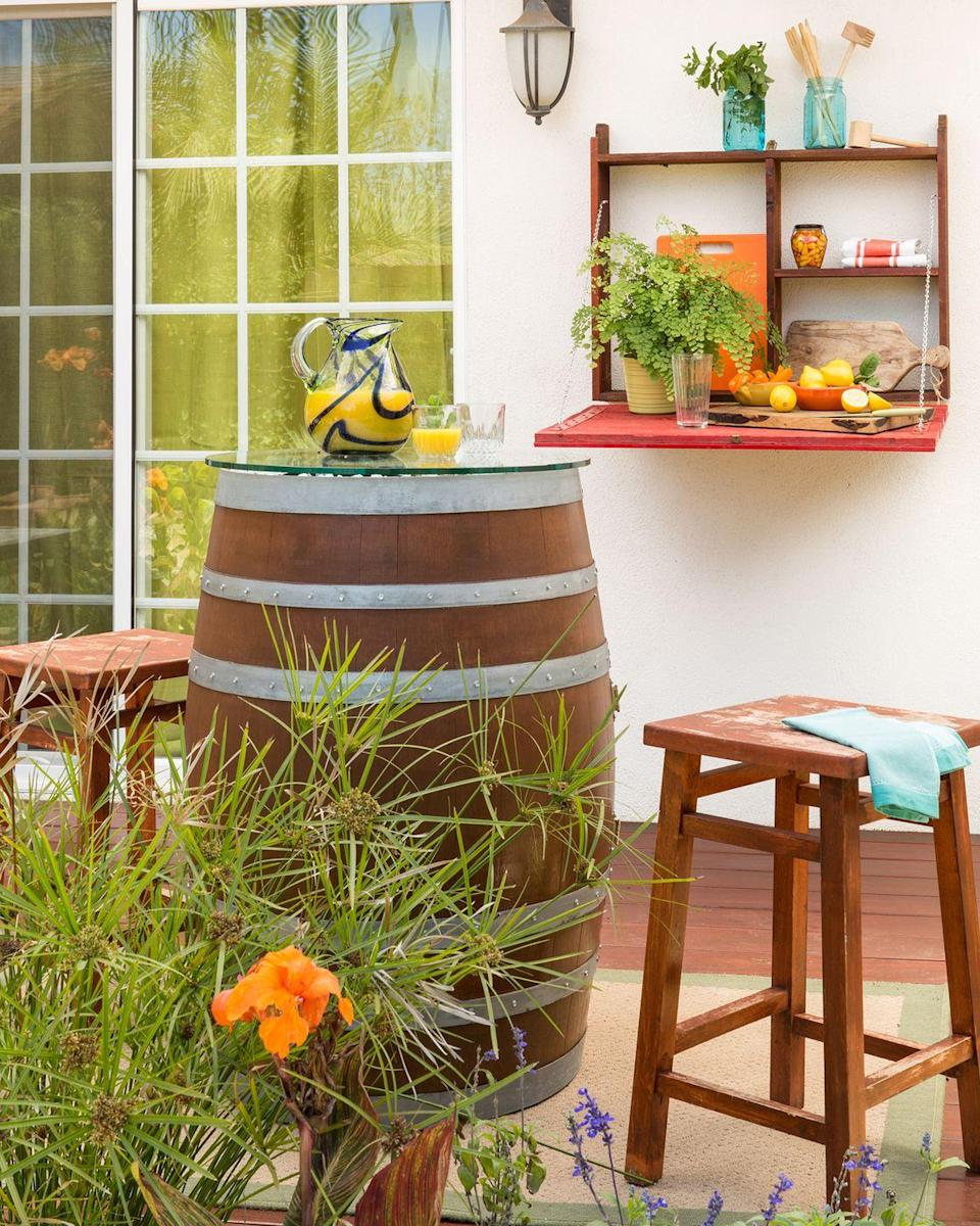 <p>You can't go wrong with taking advantage of outdoor wall space. A simple fold-out shelf can serve as the perfect spot to display small plants and outdoor entertaining essentials.</p>
