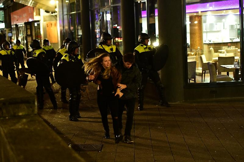 A demonstration by over 1,000 people close to the Turkish consulate in Rotterdam turned violent as authorities barred Turkish ministers from visiting (AFP Photo/Emmanuel DUNAND)