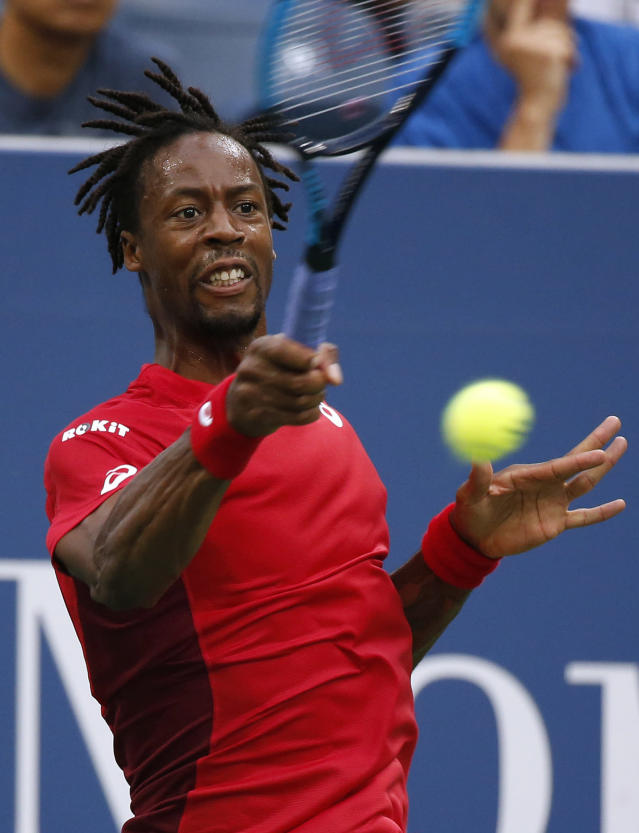 Gael Monfils, of France, returns a shot to Pablo Andujar, of Spain, during the fourth round of the U.S. Open tennis tournament, Monday, Sept. 2, 2019, in New York. (AP Photo/Jason DeCrow)