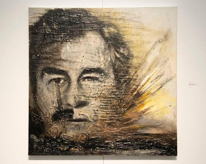"""Luma Jasim's 2015 piece """"One Coin"""" featuring the faces of Saddam Hussein and President George W. Bush is on display at Boise State's Student Union Building Fine Arts Gallery. Jasim is a Boise resident who was born and lived in Iraq for 30 years."""