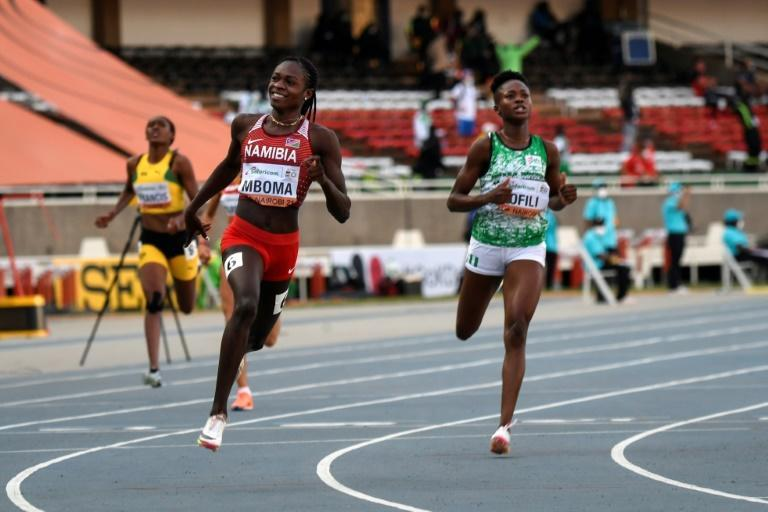 Christine Mboma (L) ran her personal best of 21.81sec at the Tokyo Olympics