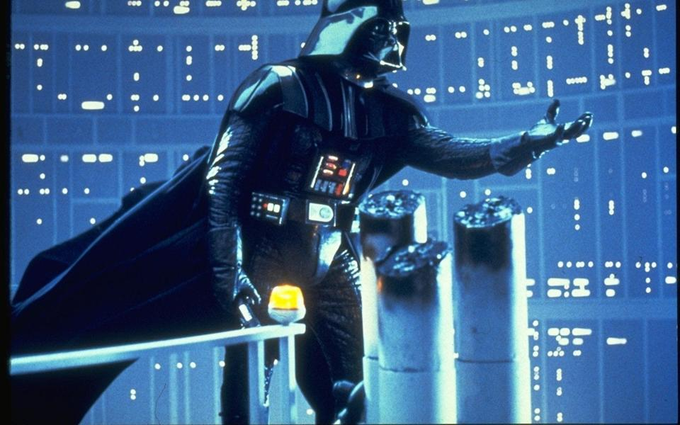 Dave Prowse, as Darth Vader, reaches out to Luke Skywalker in The Empire Strikes Back, 1980