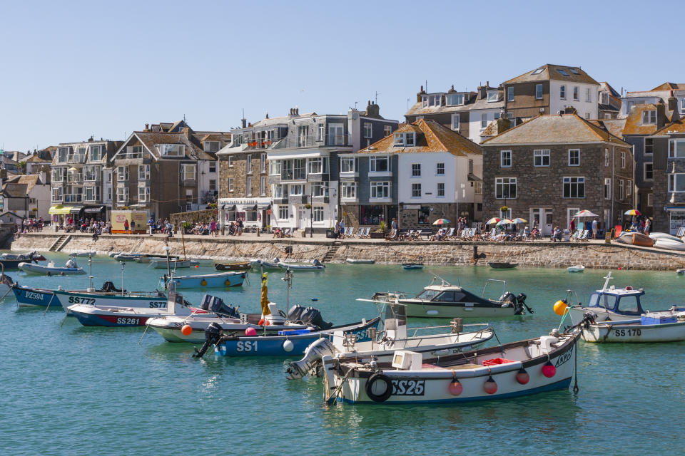 The buzzing harbour at St Ives is the perfect place to people watch. (Getty Images)