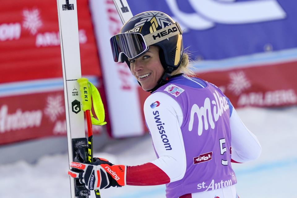Switzerland's Lara Gut-Behrami smiles at the end of an alpine ski, women's World Cup super-G in St. Anton, Austria, Sunday, Jan.10, 2021. (AP Photo/Giovanni Auletta)