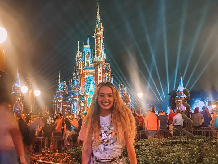 kayleigh price in front of happily ever after at magic kingdom
