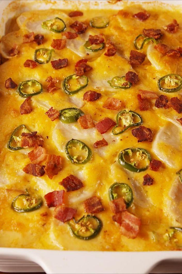 """<p>You can't go wrong with cheese and crispy potatoes.</p><p>Get the recipe from <a href=""""https://www.delish.com/cooking/recipe-ideas/recipes/a56642/jalapeno-popper-scalloped-potatoes-recipe/"""" rel=""""nofollow noopener"""" target=""""_blank"""" data-ylk=""""slk:Delish"""" class=""""link rapid-noclick-resp"""">Delish</a>.</p><p><strong><a class=""""link rapid-noclick-resp"""" href=""""https://go.redirectingat.com?id=74968X1596630&url=https%3A%2F%2Fwww.barnesandnoble.com%2Fw%2Fdelish-editors-of-delish%2F1127659306%3Fst%3DAFF%26SID%3DBarnes%2B%2526%2BNoble%2B-%2BTop%2B100%253A%2BBook%2BBestsellers%262sid%3DSkimlinks_7689440_NA&sref=https%3A%2F%2Fwww.delish.com%2Fholiday-recipes%2Fchristmas%2Fg1421%2Fchristmas-side-dishes%2F"""" rel=""""nofollow noopener"""" target=""""_blank"""" data-ylk=""""slk:GET YOURS NOW"""">GET YOURS NOW</a><em> Delish Cookbook, </em><em>barnesandnoble.com</em> </strong></p>"""