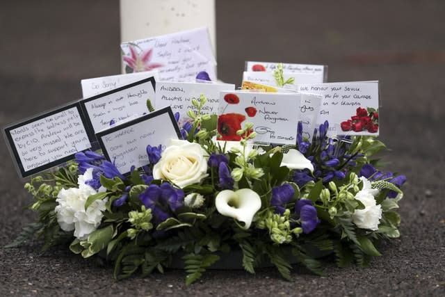A floral tribute which was laid during a memorial service for Pc Andrew Harper at Newbury police station to mark the first anniversary of his death