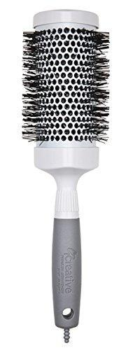 """<h3>Creative Hair Brushes Triangle Ceramic & Ionic PRO Large 3.0"""" Brush</h3><br><br>A round brush is an easy way to create volume and wave as you DIY your blowout. These salon-quality brushes help speed drying time, and seal the hair cuticle, resulting in less frizz and a silky finish."""