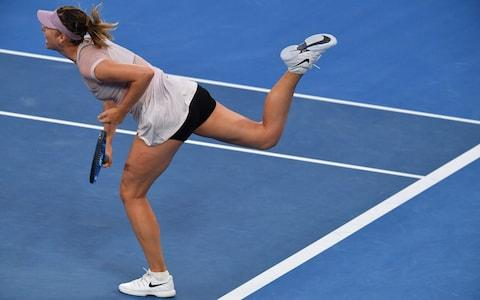 Russia's Maria Sharapova serves against Germany's Angelique Kerber during their women's singles third round match on day six of the Australian Open tennis tournament in Melbourne on January 20, 2018 - Credit: AFP