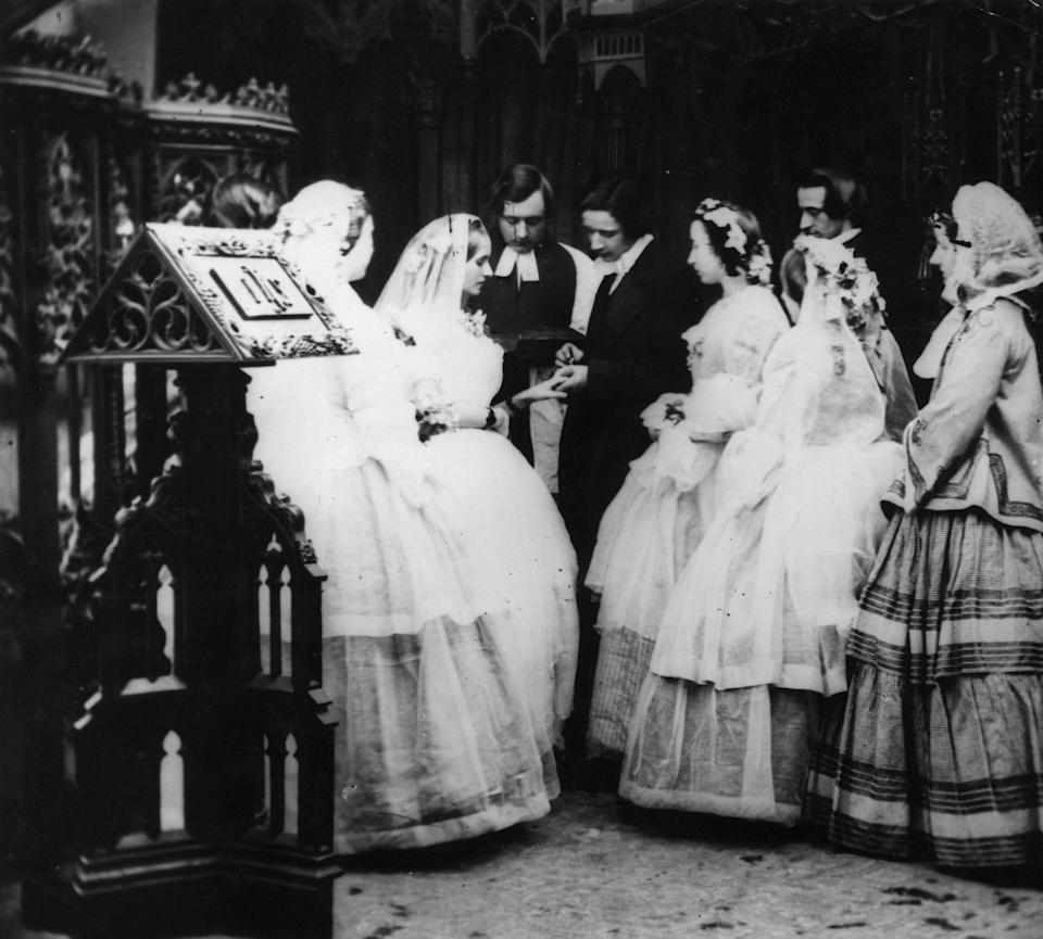 """<p>In a Victorian wedding, the bride and bridesmaids typically wore coronets in their hair and the veil was attached to the top of the head. It was typical for the bride to wear orange blossoms, while bridesmaids usually <a href=""""http://www.avictorian.com/weddingattire.html"""" rel=""""nofollow noopener"""" target=""""_blank"""" data-ylk=""""slk:wore roses or in-season flowers"""" class=""""link rapid-noclick-resp"""">wore roses or in-season flowers</a>. </p>"""