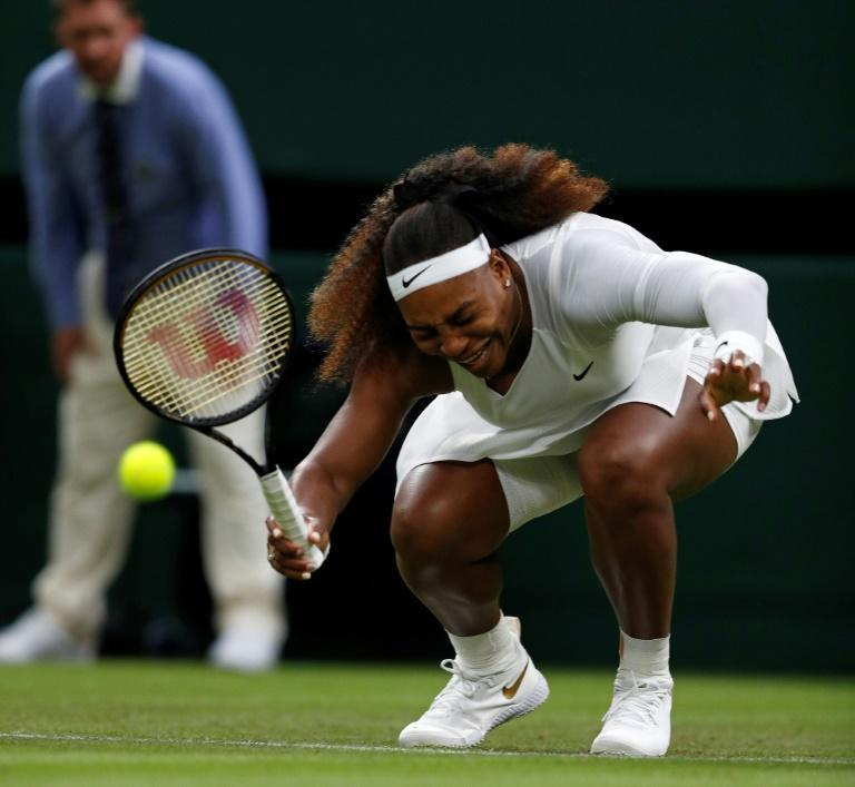 Serena Williams reacts as she pulls-up injured before withdrawing from her women's singles first round match against Aliaksandra Sasnovich