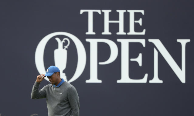 Tiger Woods of the United States tips his hat as he completes his first round of the British Open Golf Championships on the 18th green at Royal Portrush in Northern Ireland, Thursday, July 18, 2019.(AP Photo/Jon Super)
