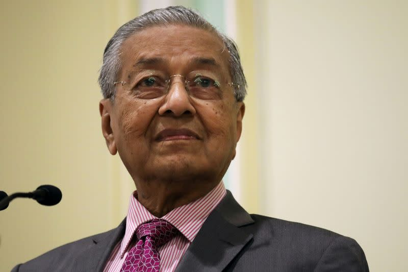 FILE PHOTO: Malaysia's Prime Minister Mahathir Mohamad reacts during a news conference in Putrajaya