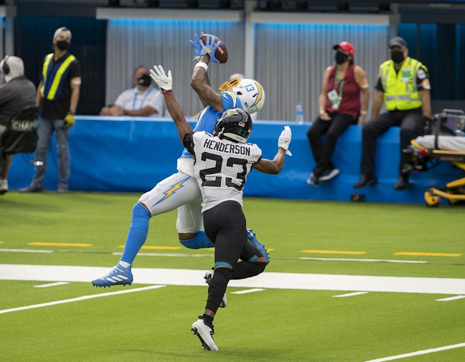 The Chargers' Keenan Allen hauls in a pass over Jaguars cornerback CJ Henderson in the first half at SoFi Stadium.