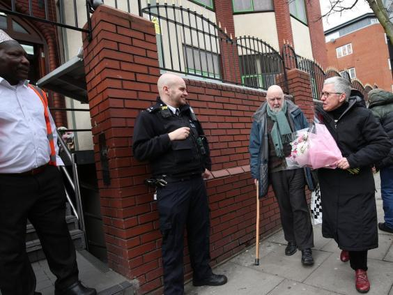 Barbara Smith arrives to leave flowers at Finsbury Park Mosque following Christchurch attacks (PA)