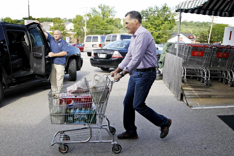Republican presidential candidate, former Massachusetts Gov. Mitt Romney pushes a shopping cart after buying groceries at Hunter's Shop and Save supermarket in Wolfeboro, N.H., Monday, Aug. 6, 2012. (AP Photo/Charles Dharapak)