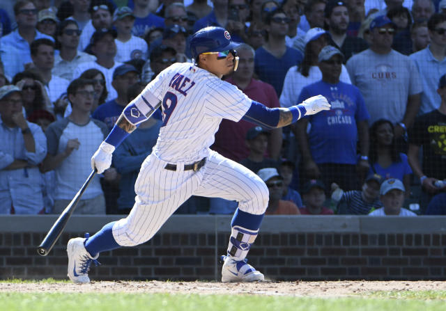 Chicago Cubs' Javier Baez (9) hits an RBI single against the Cincinnati Reds during the eighth inning of a baseball game Saturday, July 7, 2018, in Chicago. (AP Photo/David Banks)